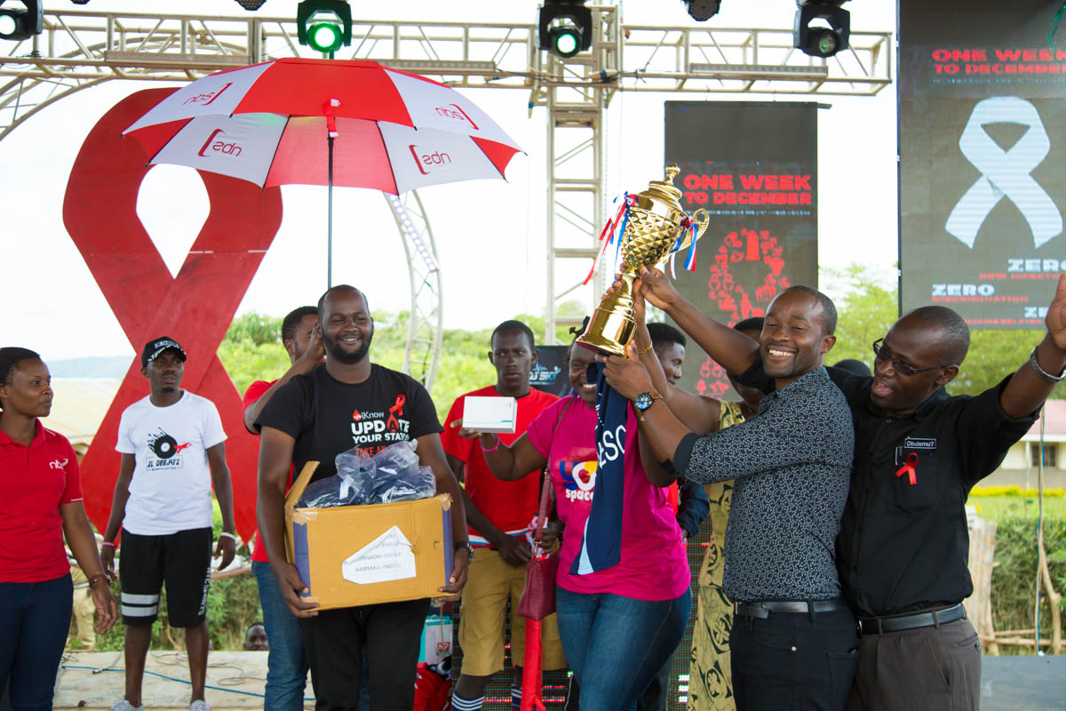 Ntare Old Boys Captain receiving their trophy after winning the Corporate League