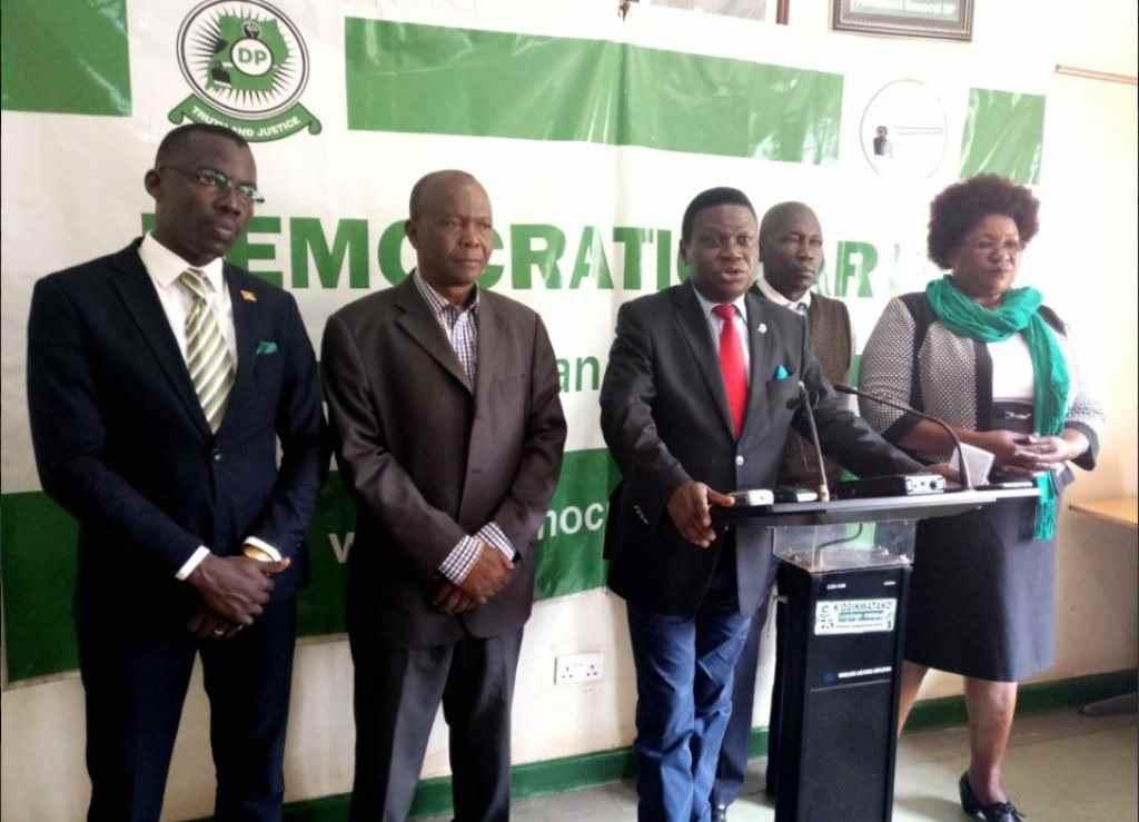 Hasibu Deo Njoki (2nd left) alongside Norbert Mao and MP Florence Namayanja