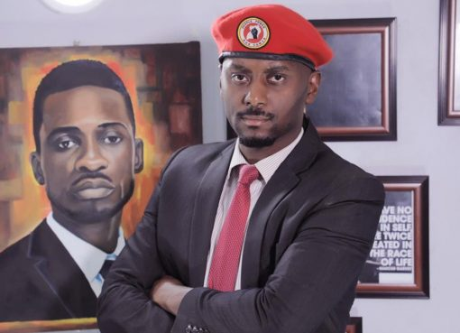 In the background is a portrait of Bobi Wine as painted by an artist. On the foreground is David Lewis Rubongoya. Courtesy Photo